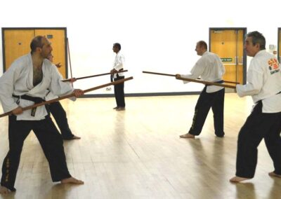 Practicing Stick v Stick sparring in class