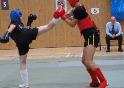Artur (16) in Sanda semi final fight against much taller fighter