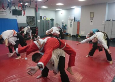 Santa joining in with some basic kickboxing stretching during class