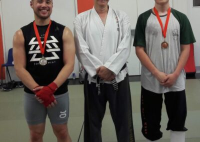 Local interclub Sparring comp medalists with their instructor