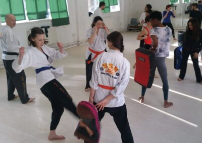 learning basic kicks and padwork in class